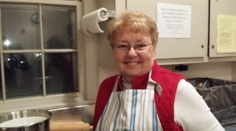 Connie Hopkins works late in the church kitchen baking apple pies for the Apple Social.